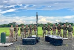 Tech. Sgt. Darlene Byers, 571st Mobility Support Advisory Squadron air advisor for the Radar, Airfield and Weather Systems, left, poses for a group photo with personnel from the National Air and Naval Service, or SENAN, at Nicanor Air Base, Panama. As an instructor, Byers provided critical training on the weather system at the height of Panama's rainy season. (Courtesy Photo)