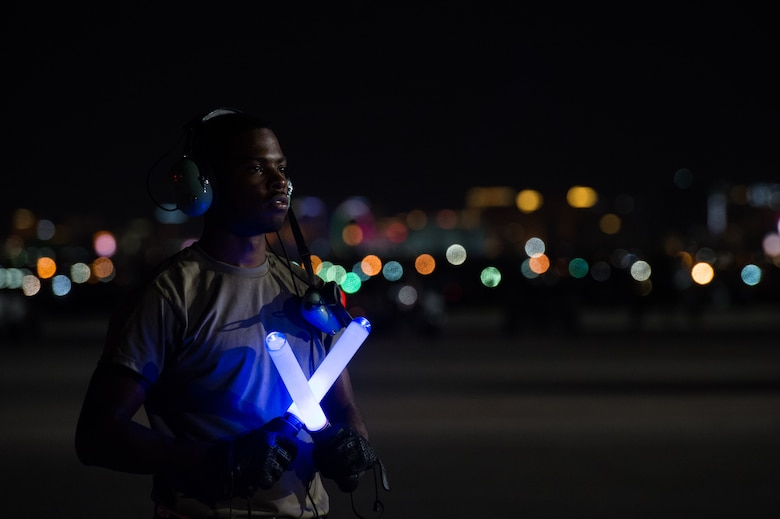 Airman prepares to launch an F-22 Raptor