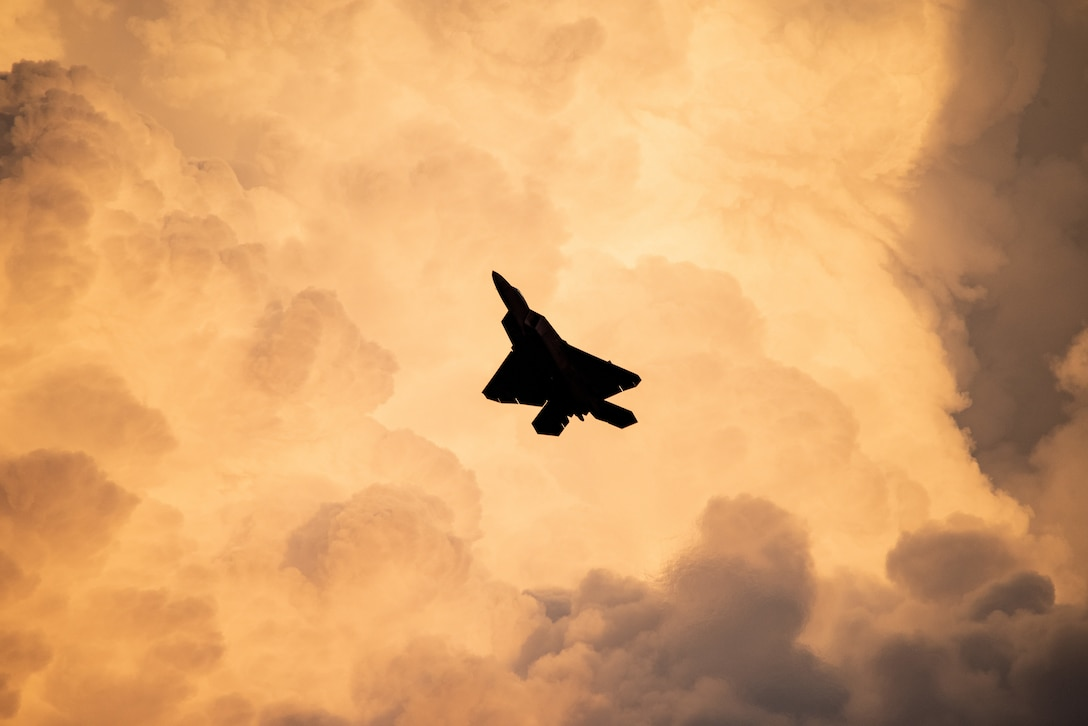 F-22 flies a twilight demonstration during