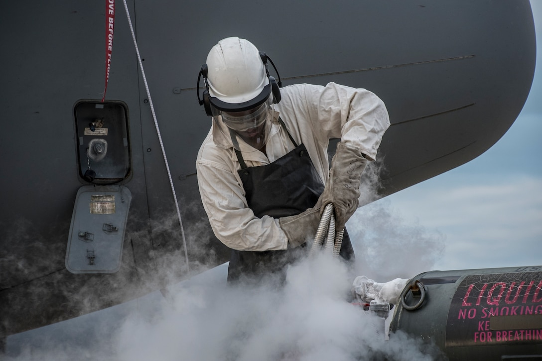 Tech. Sgt. refills the C-130H Hercules with liquid oxygen