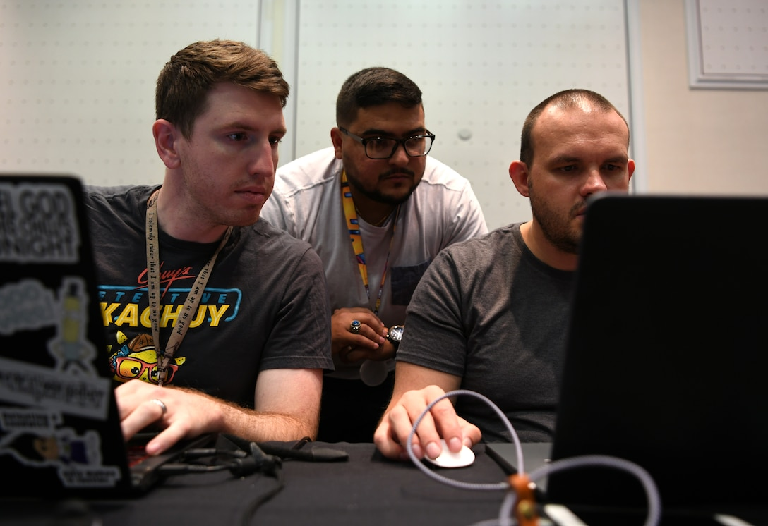 Air Force cyber warfare operators set up their computer stations before a capture-the-flag competition during DEF CON 27 Hacking Conference in Las Vegas, Aug. 8, 2019. The operators participated in a number of DEF CON events to showcase their knowledge and experience. (U.S. Air Force photo by Tech. Sgt. R.J. Biermann)