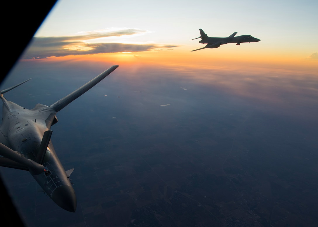 Two U.S. Air Force 7th Bomb Wing B-1B Lancers, perform air refueling training with a 92nd Air Refueling Wing KC-135 Stratotanker at Dyess Air Force Base, Texas, Aug. 13, 2019.
