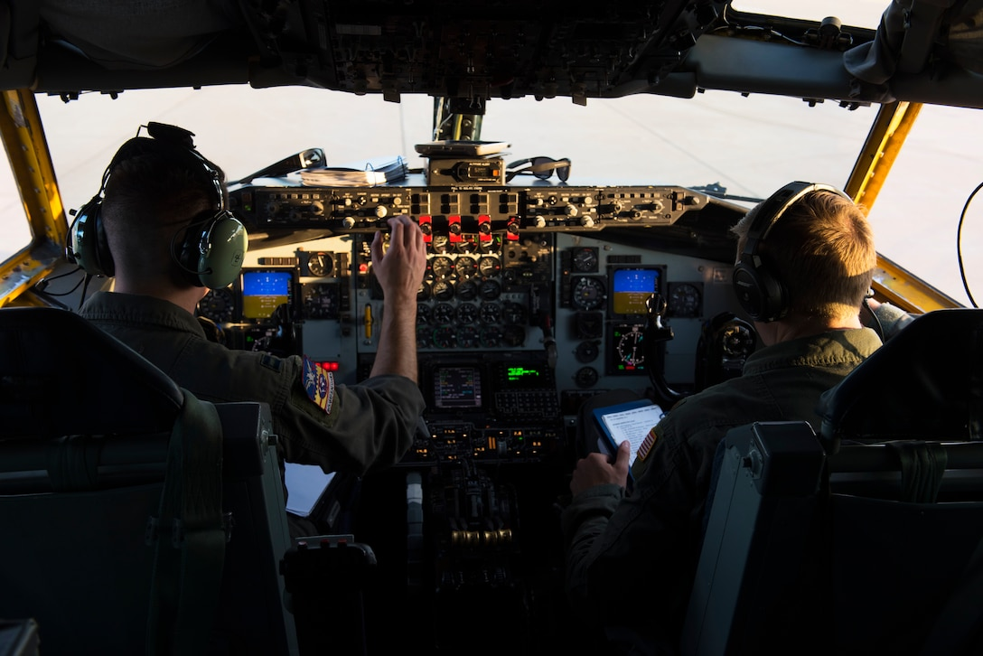 U.S. Air Force Capt. Howard Palmer (left) and Maj. Britton Adamson (right), 384th Air Refueling Squadron pilots, perform pre-flight checks prior to air refueling training with B-1B Lancers assigned to the 7th Bomb Wing at Dyess Air Force Base, Texas, Aug. 14, 2019.
