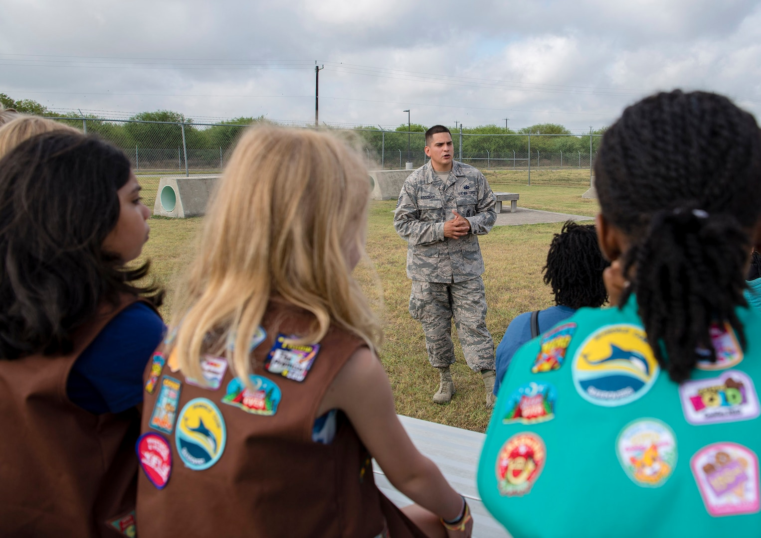 South West Texas Girl Scout Troop 367 toured Joint Base San Antonio-Randolph Aug. 9,  witnessing a military working dog demonstration at the 902nd Security Forces Squadron kennel, visiting the 902nd Civil Engineer Squadron fire department and touring the base's static aircraft display. (U.S. Air Force photo by Sabrina Fine)