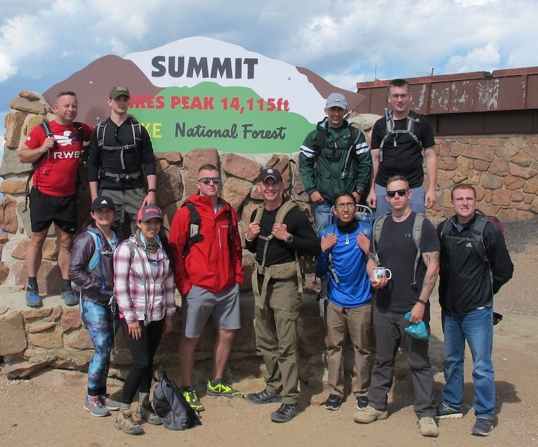 Airmen from the 50th Space Communications Squadron at Schriever Air Force Base, Colorado, gather after summiting Pikes Peak, at Pike National Forest, Colorado, Aug. 14, 2019. The group summited the peak to instill esprit de corps and to challenge their comprehensive Airman fitness. (U.S. Air Force photo by Master Sgt. Thomas Locke)
