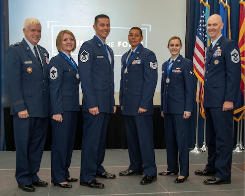 U.S. Air Force Lt. Gen. L. Scott Rice, director of the Air National Guard (ANG), Chief Master Sgt. Rachel L. Landegent, Master Sgt. Mark J. Jurakovich, Tech. Sgt. Andrew Merrylees, Airman 1st Class Kaleigh M. Bevan and Command Chief Master Sgt. Ronald C. Anderson, ANG command chief, pose for photo during the recognition ceremony of Focus on the Force held at the Air National Guard Readiness Center, Joint Base Andrews, Md., Aug. 15, 2019. Focus on the force week is a week-long series of events, with emphasis on Air National Guard enlisted force growth and development through collaboration of leadership and subject matter experts including the ANG's four Outstanding Airmen of the Year. (U.S. Air National Guard photo by Master Sgt. David J. Fenner)