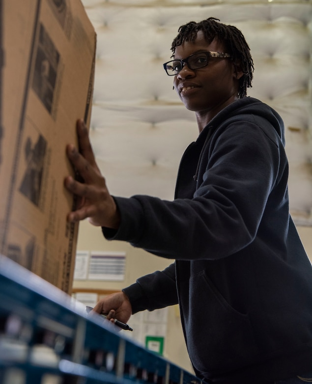 Peggy Moore, 50th Logistics Readiness Flight supply technician, helps unload packages in the warehouse at Schriever Air Force Base, Colorado, Aug. 14, 2019. The 50th LRF screens every package sent to Schriever AFB to ensure no explosives or harmful substances are delivered around the base. (U.S. Air Force photo by Airman 1st Class Jonathan Whitely)