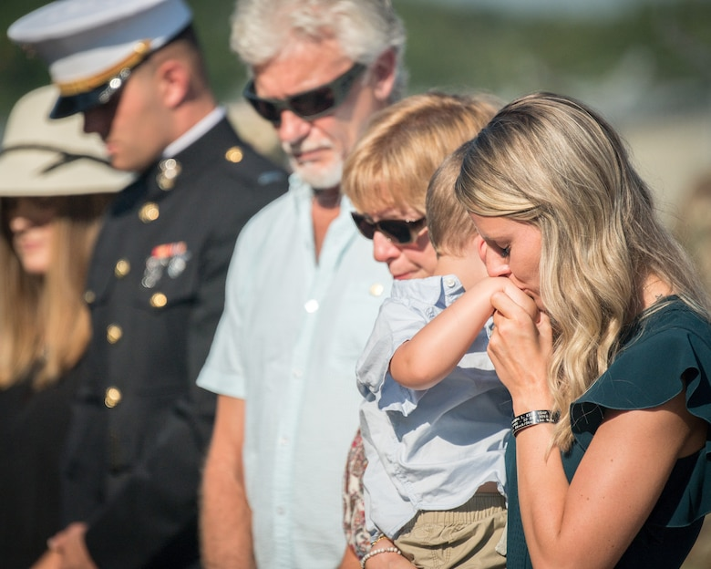 Alyssa Kidd comforts Beckham Kidd while the family comes together for the renaming of the Weapons Load Training facility at Barksdale Air Force Base, Louisiana, to the Kidd Weapons Load Training facility in honor of the late Tech. Sgt. Joshua L. Kidd Aug. 16, 2019.