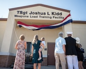 The Kidd family unveil the new name of the Kidd Weapons Load Training facility at Barksdale Air Force Base, Louisiana, in honor of the late Tech. Sgt. Joshua L. Kidd Aug. 16, 2019.