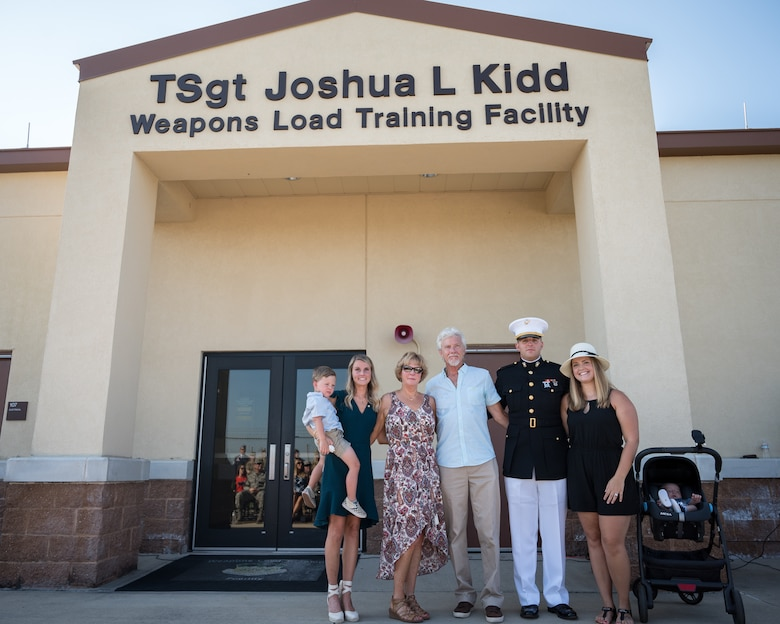 The Kidd family come together for the renaming of the Weapons Load Training facility at Barksdale Air Force Base, Louisiana, to the Kidd Weapons Load Training facility in honor of the late Tech. Sgt. Joshua L. Kidd Aug. 16, 2019.
