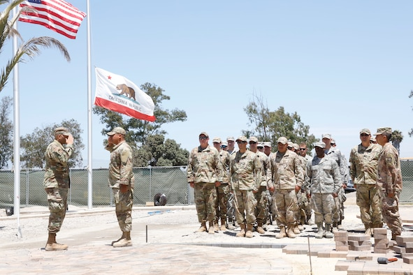 U.S. Air National Guard members from the 146 Civil Engineer Squadron perform a re-enlistment ceremony outside the headquarters building at the Channel Islands Air National Guard Station, August 9, 2019. U.S. Air National Guard photo by Senior Airman Todd Senff.