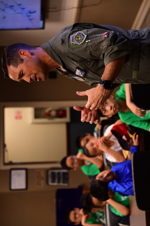 U.S. Air National Guard Col. Keith Ward commander 146th Airlift Wing, converses with a group of students attending a summer camp with St. Stephen's Academy during a base tour at the Channel Islands Air National Guard Station, Port Hueneme, CA. July 25, 2019. (U.S. Air National Guard photo by Tech. Sgt. Nieko Carzis)