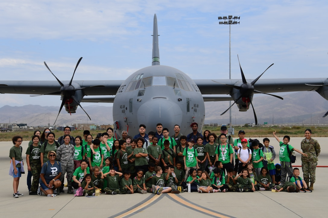 U.S. Air National Guard personnel from the 146th Airlift Wing provide a base tour to students attending a summer camp with St. Stephen's Academy at the Channel Islands Air National Guard Station, Port Hueneme, CA. July 25, 2019. (U.S. Air National Guard photo by Tech. Sgt. Nieko Carzis)