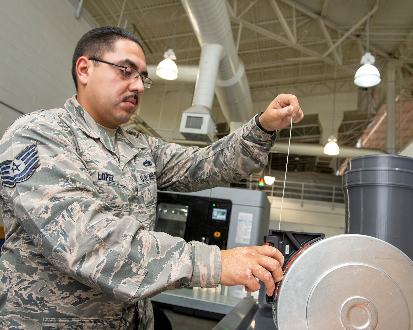 Travis AFB is the first field-unit location in the Air Force to have the Stratays F900 3-D industrial printer certified by the Federal Aviation Administration and Air Force Advanced Technology and Training Center for use on aircraft replacement parts. (U.S. Air Force photo by Louis Briscese)