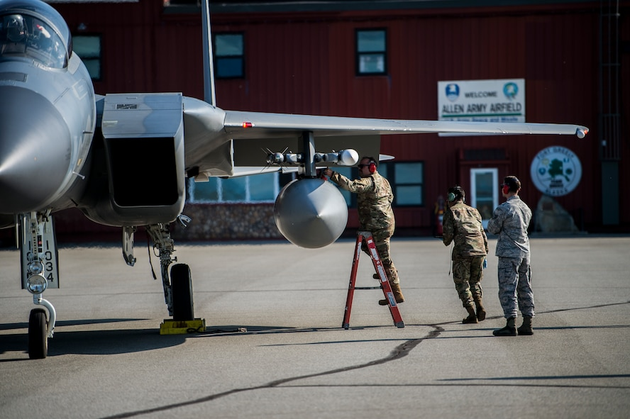 U.S. Airmen assigned to the 67th Aircraft Maintenance Unit, Kadena Air Base, Japan, prepare an F-15 Eagle for takeoff at Allen Army Airfield during Red Flag-Alaska 19-3 at Fort Greely, Alaska, Aug. 8, 2019. During the exercise, Fort Greely was used to implement agile combat employment, which allows aircraft maintainers to perform maintenance operations in remote locations with as few people as possible. (U.S. Air Force photo by Senior Airman Isaac Johnson)