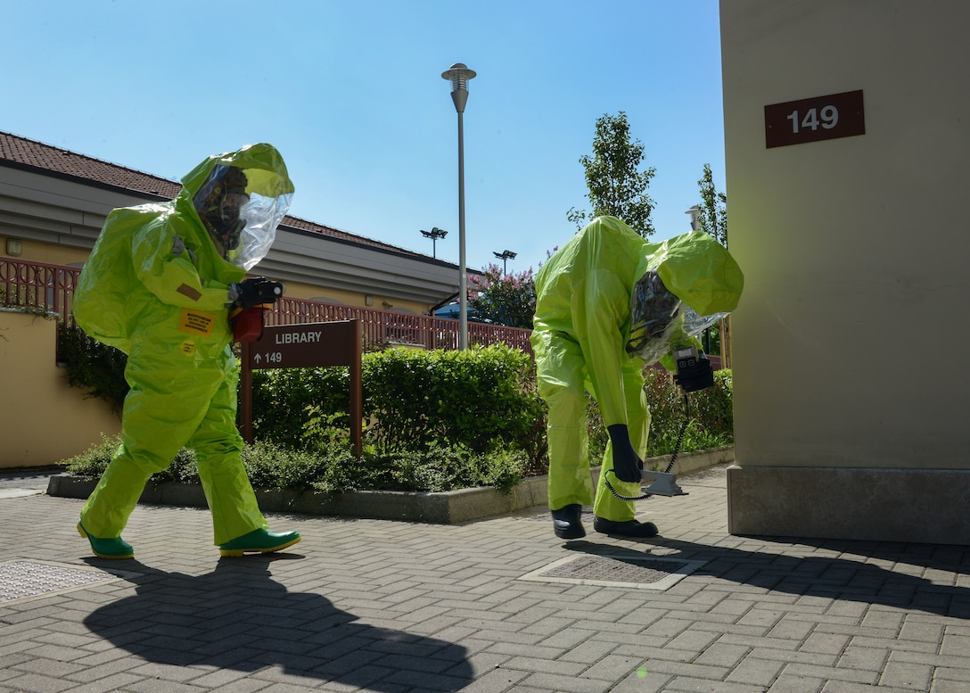Airmen from the 31st Aerospace Medicine Squadron Bioenvironmental Engineering flight read a mock hazardous scene during exercise Ready EAGLE at Aviano Air Base, Italy, Aug. 9, 2019. To prevent contamination or danger to first responders and other personnel, BE monitors a variety of different potentially hazardous issues, such as chemicals and radioactivity. (U.S. Air Force photo by Staff Sgt. Rebeccah Woodrow)