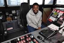 MSC Civil Service Mariner Abraham Asante, first engineer of the Spearhead-class expeditionary fast transport ship USNS Carson City (T-EPF 7), poses for a photo while standing bridge watch in support of the ship's Africa Partnership Station deployment.
