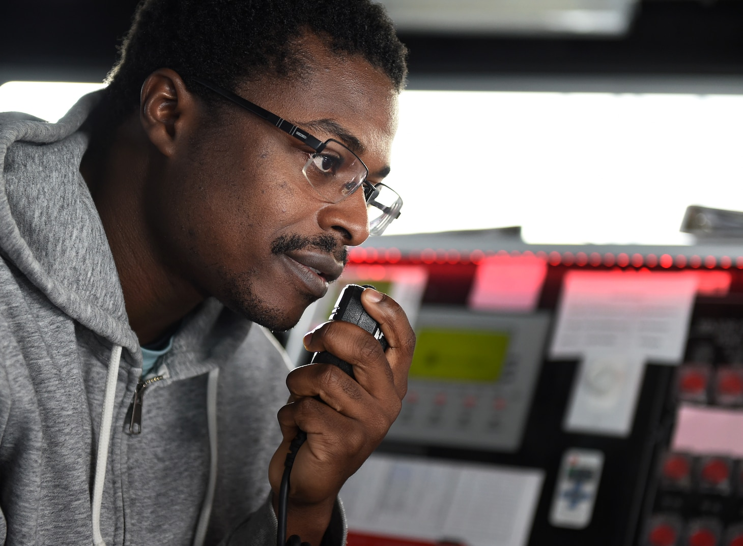 MSC Civil Service Mariner Abraham Asante, first engineer of the Spearhead-class expeditionary fast transport ship USNS Carson City (T-EPF 7), talks with an engineering team conducting rounds while standing bridge watch in support of the ship's Africa Partnership Station deployment.