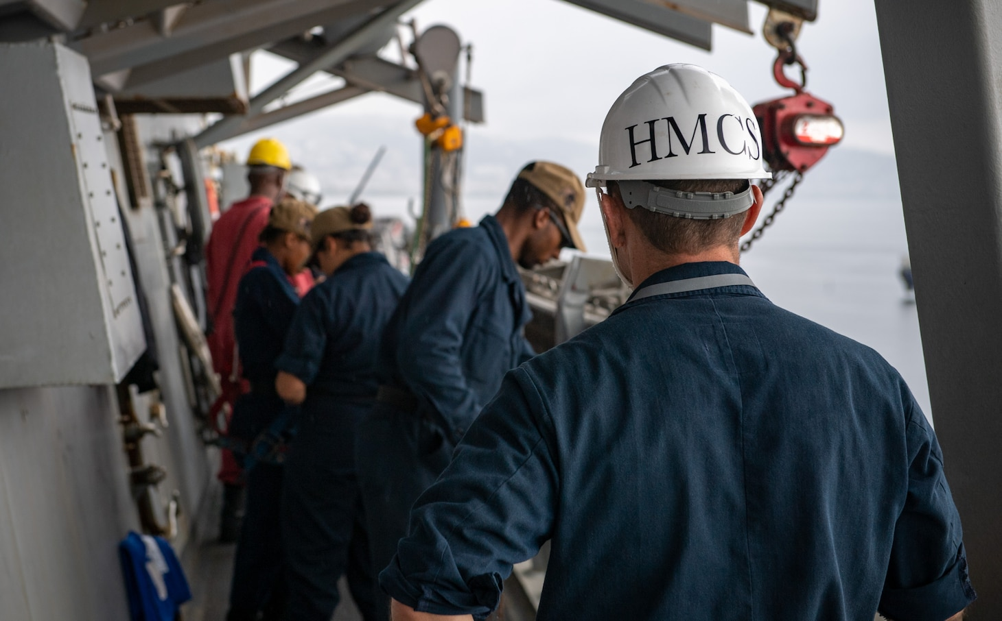 Senior Chief Hospital Corpsman Jermy Brower, assigned to the Arleigh Burke-class guided-missile destroyer USS Porter (DDG 78), stands a medical coverage watch during a sea and anchor detail as the ship arrives in Golcuk, Turkey, Aug. 16, 2019.