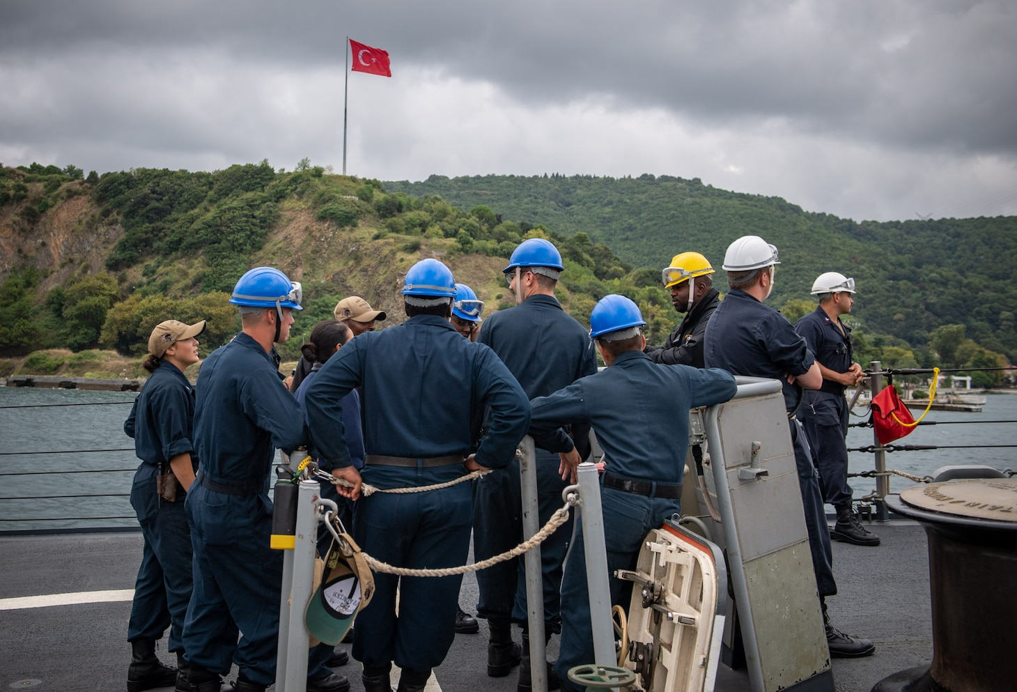 Sailors assigned to the Arleigh Burke-class guided-missile destroyer USS Porter (DDG 78) stand by during a sea and anchor detail as the ship prepares to arrive in Golcuk, Turkey, Aug. 16, 2019.