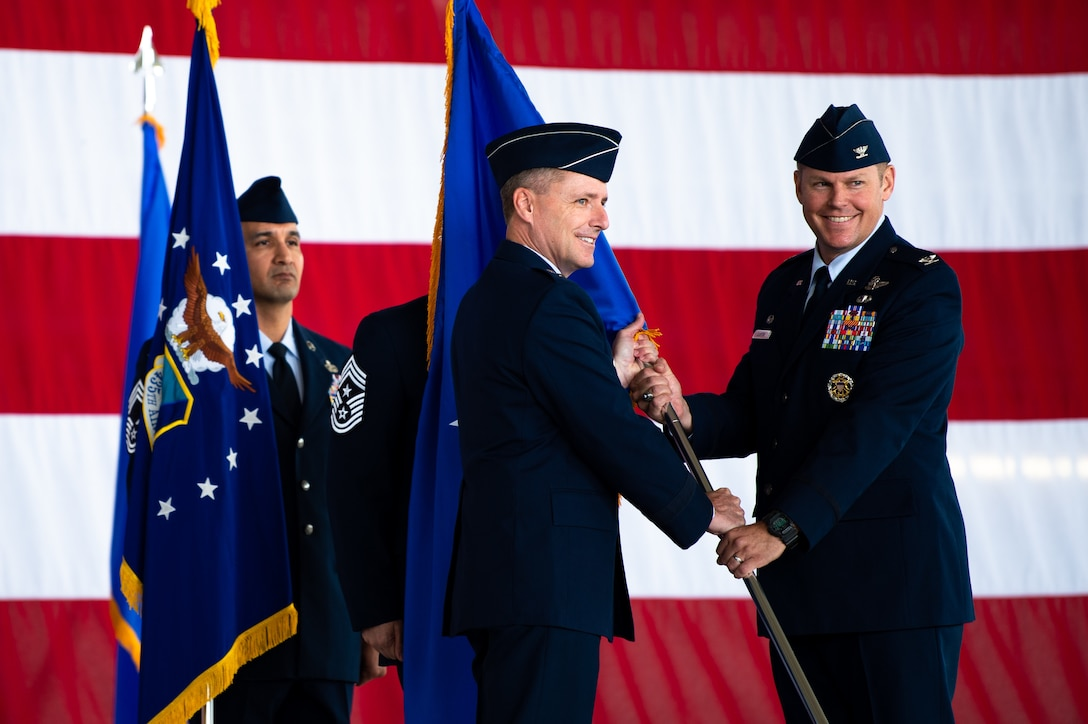 U.S. Air Force Col. Daniel C. Clayton, right, assumes command of the 435th Air Ground Operations Wing and 435th Air Expeditionary Wing, from Maj. Gen. John M. Wood, Third Air Force commander, at Ramstein Air Base, Germany, Aug. 16, 2019. The two wings provide battlefield and expeditionary Airmen to combatant commanders, and are capable of responding to humanitarian and contingency operations throughout the world. (U.S. Air Force photo by Staff Sgt. Devin Boyer)