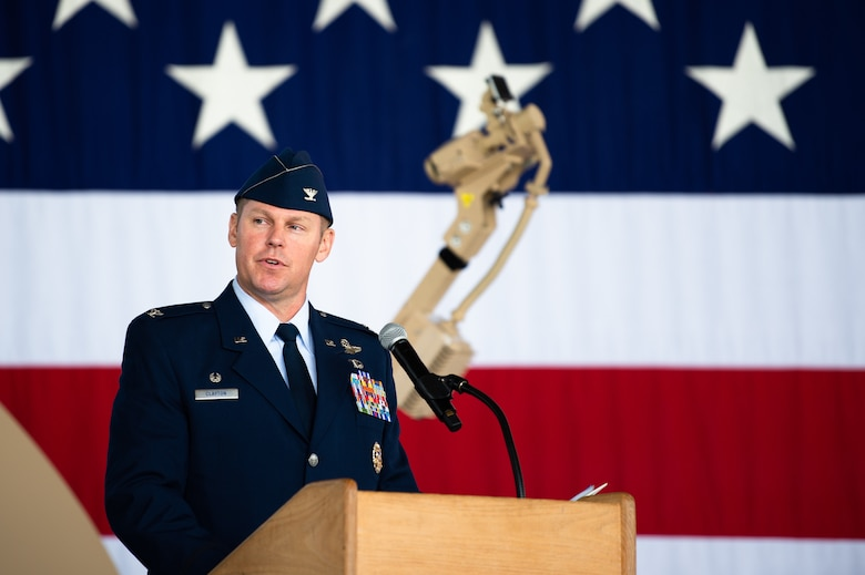 U.S. Air Force Col. Daniel C. Clayton, 435th Air Ground Operations Wing and 435th Air Expeditionary Wing commander, gives a speech during an assumption of command ceremony at Ramstein Air Base, Germany, Aug. 16, 2019. The two wings provide battlefield and expeditionary Airmen to combatant commanders, and are capable of responding to humanitarian and contingency operations throughout the world. (U.S. Air Force photo by Staff Sgt. Devin Boyer)