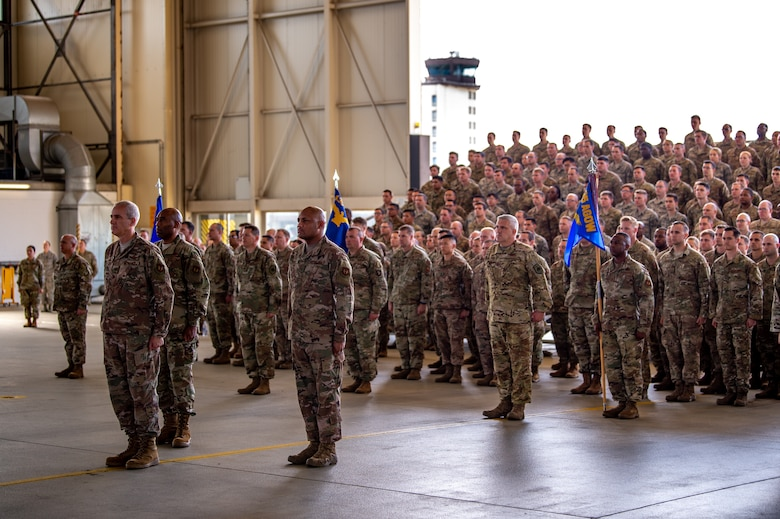 Airmen from the 435th Air Ground Operations Wing and 435th Air Expeditionary Wing stand at attention during an assumption of command ceremony at Ramstein Air Base, Germany, Aug. 16, 2019. U.S. Air Force Col. Daniel C. Clayton assumed command of the two wings from Maj. Gen. John M. Wood, Third Air Force commander. (U.S. Air Force photo by Staff Sgt. Devin Boyer)