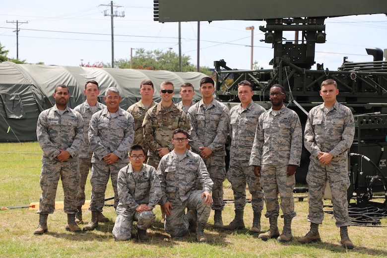 Members of the 752nd Operations Support Squadron assemble their Tactical Operations Center for Exercise Excellent Fury in Savannah, GA, July 2019. Excellent Fury, hosted by the 134th Air Control Squadron, invited these twelve Airmen to participate. Back row from left: Amn. First Class Holmes, Staff Sgt. Pearson, Master Sgt. Chou, Staff Sgt. Dyckman, Maj. Hagardt, Amn. First Class Davis, Amn. Montemayor, Amn. First Class Anderson, Mooney and Rawat.  Front row: Amn. First Class Wang and Nielsen. (U.S. Air Force courtesy photo).