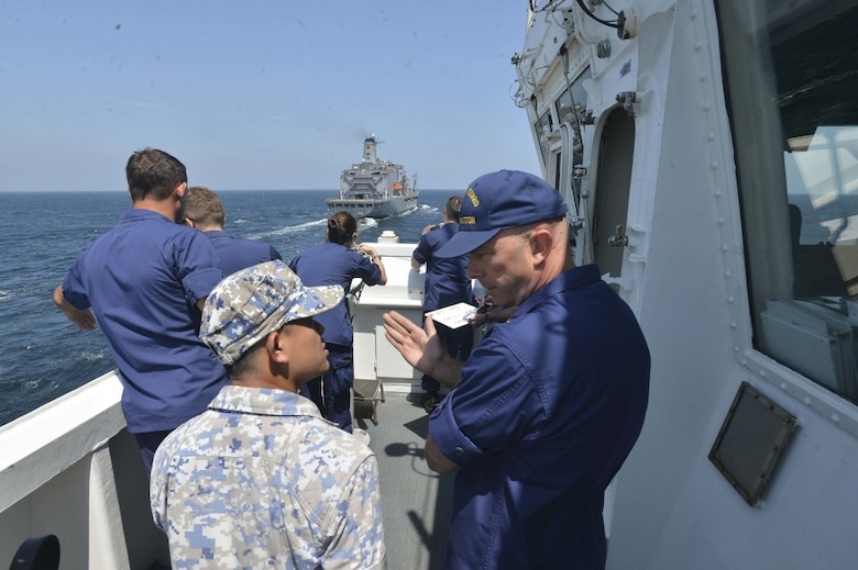 LUMUT, Malaysia (Aug 17, 2019) Capt. Bob Little, commander of the U.S. Coast Guard Cutter Stratton (WMSL 752) explains the process of a replenishment-at-sea (RAS) to a Royal Malaysian sailor as part of the at-sea phase of Maritime Training Activity (MTA) Malaysia 2019. MTA Malaysia 2019 is a continuation of 25 years of maritime engagements between the U.S. Navy and Royal Malaysian Navy serving to enhance mutual capabilities in ensuring maritime security and stability.