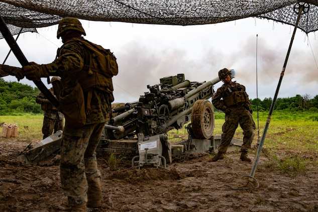 U.S. Marines with 3rd Battalion, 12th Marine Regiment, 3rd Marine Division, fire a M777 Howitzer during The Artillery Relocation Training Program in Ojojihara, Japan, July 25, 2019. ARTP provides 12th Marine Regiment with essential, live-fire training outside Okinawa to increase combat readiness and support the Treaty of Mutual Cooperation and Security. (U.S. Marine Corps photo by Lance Cpl. Christine Phelps)