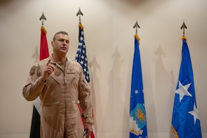 Lt. Gen. Joseph T. Guastella, U.S. Air Force Central Command commander, speaks to an audience about the accomplishments of the Air Warfare Center under the command of Col. Jason Hokaj during a change of command ceremony June 19, 2019, at Al Dhafra Air Base, United Arab Emirates.
