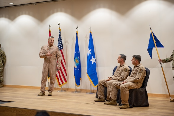Lt. Gen. Joseph T. Guastella, U.S. Air Force Central Command commander, speaks to Col. Jason Hokaj and Col. Thomas Wolfe during the Air Warfare Center change of command ceremony June 19, 2019, at Al Dhafra Air Base, United Arab Emirates.