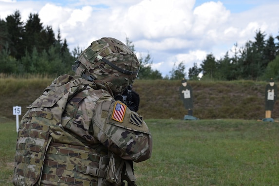 Master Sgt. Carlos Garcis, 2500th Digital Liaison Detachment acting sergeant major, fires his M4 carbine weapon during a familiarization range Aug. 14 at Grafenwoehr Training Area in Germany. The 2500th DLD is conducting basic warrior tasks and familiarizing themselves with battlefield enablers during annual training.