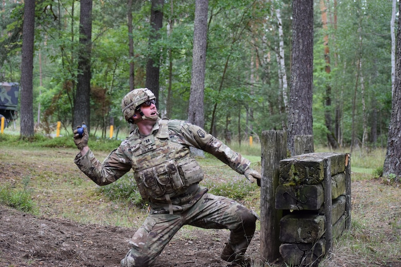 Capt. Michael E. Benjamin, 2500th DLD operations officer, throws a practice hand grenade during a familiarization and qualification range Aug. 16 at Grafenwoehr Training Area in Germany.