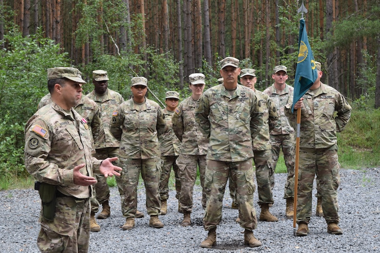 The outgoing commander of the 2500th Digital Liaison Detachment, Col. Christopher Varhola, thanks his Soldiers after receiving a meritorious service medal during a ceremony Aug. 17 at Camp Normandy, Grafenwoehr, Germany. Varhola will retire this November after almost 30 years of service in the U.S. Army.