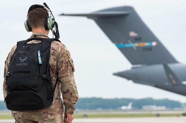 An Airman walks down the flight line carrying his backpack June 18, 2019, on Dover Air Force Base, Del. Metaphorically speaking, each of us may carry our personal backpacks filled with day-to-day struggles of life that are not visible to our Wingmen, family members and others. For Dover Airmen or family members in need of help, visit https://www.dover.af.mil/-We-Care-Guide/. (U.S. Air Force photo by Roland Balik)