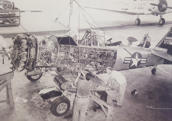 Maintenance being done on an AT-6 Texan. When the Air Force became a separate service, it consolidated pilot training from three phases- primary, basic and advanced-to two phases- basic and advanced, which later became known as the primary and basic phases.