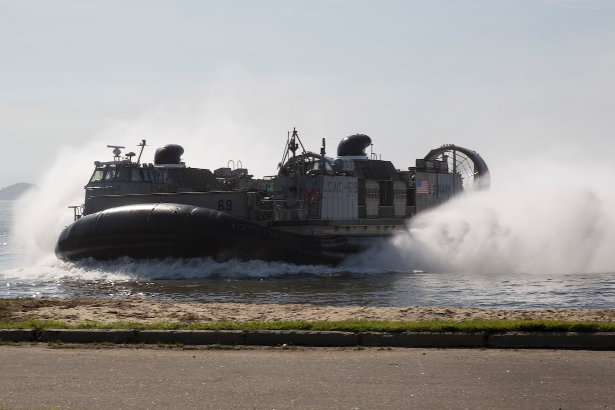 A U.S. Navy amphibious craft lands ashore.