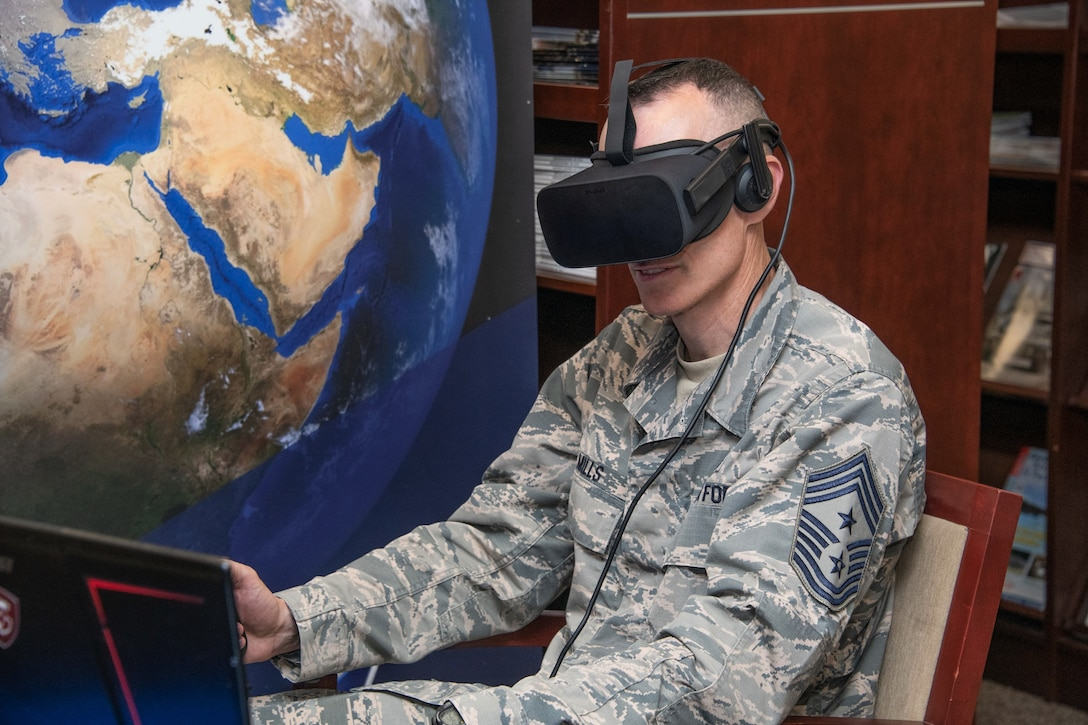 Chief Master Sgt. Lee Mills, 673rd Air Base Wing command chief from Joint Base Elmendorf-Richardson, Alaska, tests out virtual reality Aug. 13, 2019, during the Air University wing commander's orientation on Maxwell Air Force Base, Alabama. Just one of the many projects the attendees had the opportunity to learn about was Air University's application of virtual and mixed-reality as a means of enhancing the training of Airmen.