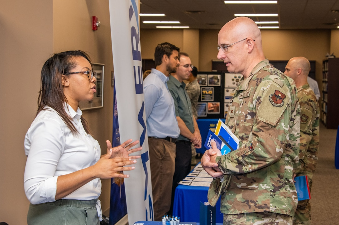 A wing commander attending Air University's immersion orientation speaks with a representative from the school, Aug. 13, 2019, on Maxwell Air Force Base, Alabama. The event was designed to showcase how Air University has changed since some of them attended courses and the strides made in educating future leaders.