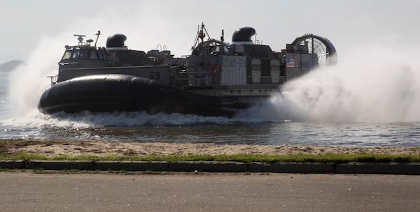 U.S. Navy landing craft comes ashore.