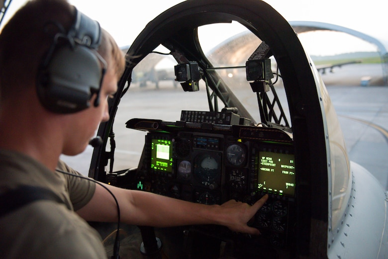 Airman 1st Class Tanner Giroux, 75th Aircraft Maintenance Unit (AMU) avionics technician, checks avionics systems from the cockpit of an A-10C Thunderbolt II, Aug. 9, 2019, at Moody Air Force Base, Ga. The 75th AMU is responsible for the upkeep and maintenance of the Air Force's largest operational A-10C Thunderbolt II fighter group. (U.S.  Air Force photo by 2nd Lt. Kaylin P. Hankerson)