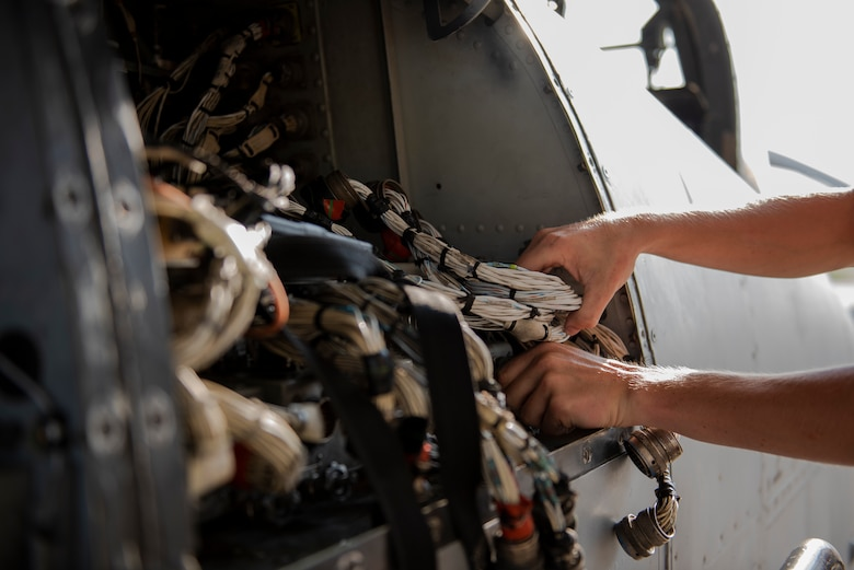 Airman 1st Class Tanner Giroux, 75th Aircraft Maintenance Unit (AMU) avionics technician, works on the wiring of an A-10C Thunderbolt II, Aug. 8, 2019, at Moody Air Force Base, Ga. The 75th AMU is responsible for the upkeep and maintenance of the Air Force's largest operational A-10C Thunderbolt II fighter group. (U.S.  Air Force photo by 2nd Lt. Kaylin P. Hankerson)