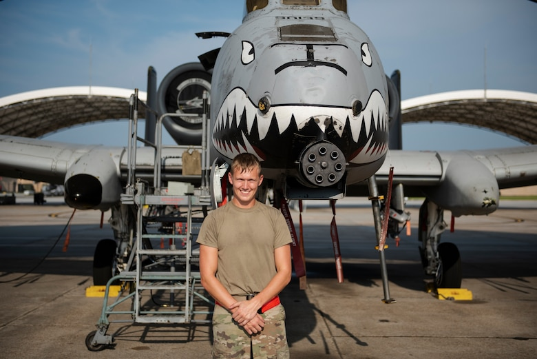 Airman 1st Class Tanner Giroux, 75th Aircraft Maintenance Unit (AMU) avionics technician, poses in front of an A-10C Thunderbolt II, Aug. 8, 2019, at Moody Air Force Base, Ga. The 75th AMU is responsible for the upkeep and maintenance of the Air Force's largest operational A-10C Thunderbolt II fighter group. (U.S.  Air Force photo by 2nd Lt. Kaylin P. Hankerson)