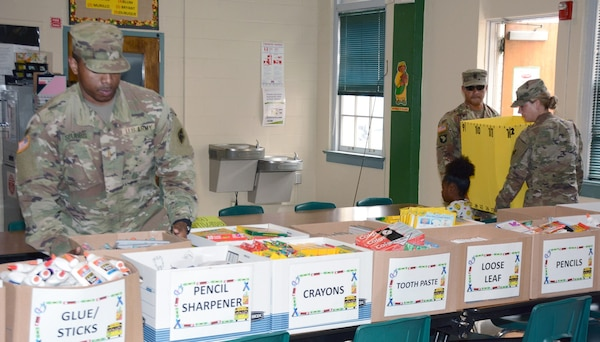 187th Medical Battalion Soldiers deliver donated supplies at Briscoe Elementary School Aug. 8.