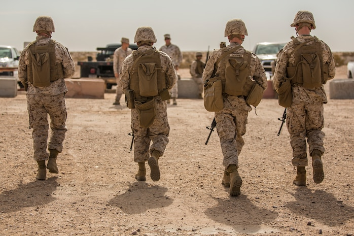 U.S. Marines stationed on Marine Corps Air Station (MCAS) Yuma, Ariz., conduct live-fire training qualifications during tables three and four of Combat Marksmanship Coach's Course 3-19 at MCAS Yuma's Range 1 , July 29, 2019. Tables three and four require that Marines shoot targets at unknown distances from supporting firing positions. (U.S. Marine Corps photo by Cpl. Sabrina Candiaflores)