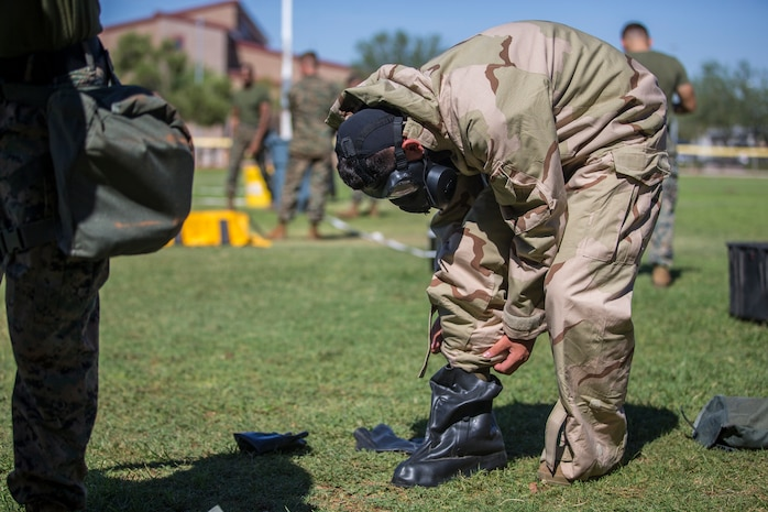 U.S. Marines stationed at Marine Coprs Air Station (MCAS) Yuma, recieve their training in order to become a squadron decontamination team at MCAS Yuma, Ariz., August 14, 2019. Each squadron is required to have a decontamination team that is trained quarterly by a Chemical, Biological, Radiological and Nuclear Defense Specialist. (U.S. Marine Corps photo by Lance Cpl. John Hall)