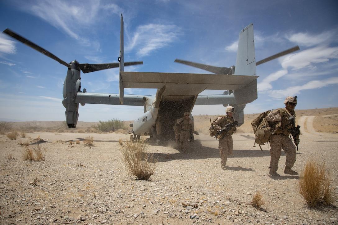 Marines exit an aircraft.