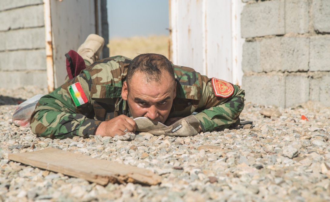 A Zeravani policeman from 2nd Battalion 3rd Brigade Zeravani checks for possible a improvised explosive devices (IED) during Counter-IED detect and defeat training at Bnaslawa Training Center, Iraq, July 25, 2019. Peshmerga police conduct detect and defeat training to identify and properly disrupt IEDs commonly found on the battlefield. The Italian Army Mobile Training Team from the Kurdistan Training Coordination Center oversaw the training. Combined Joint Task Force- Operation Inherent Resolve training programs include courses in areas as diverse as operational planning, counter-terrorism, logistics and sustainment, equipment maintenance, counter-IED techniques and law enforcement. (U.S. Army photo by Spc. Kahlil Dash)