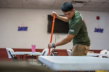 U.S. Marines stationed at Marine Corps Air Station (MCAS) Yuma, participate in the MCAS Yuma Single Marine Program's (SMP) volunteer event at the Crossroads Mission in Yuma, Ariz., August 10, 2019. The Marines served food, cleaned, and prepared food for the mission. (U.S. Marine Corps photo by Cpl. Sabrina Candiaflores)